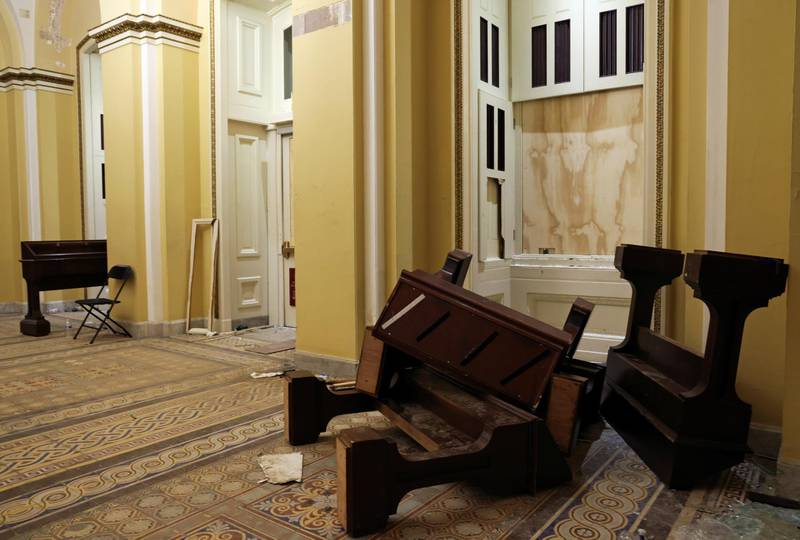 Furniture litter a hallway after supporters of U.S. President Donald Trump occupied the U.S. Capitol Building, after the Congress reconvened to certify the Electoral College votes of the 2020 presidential election, in Washington, U.S. January 7, 2021. REUTERS/Jonathan Ernst