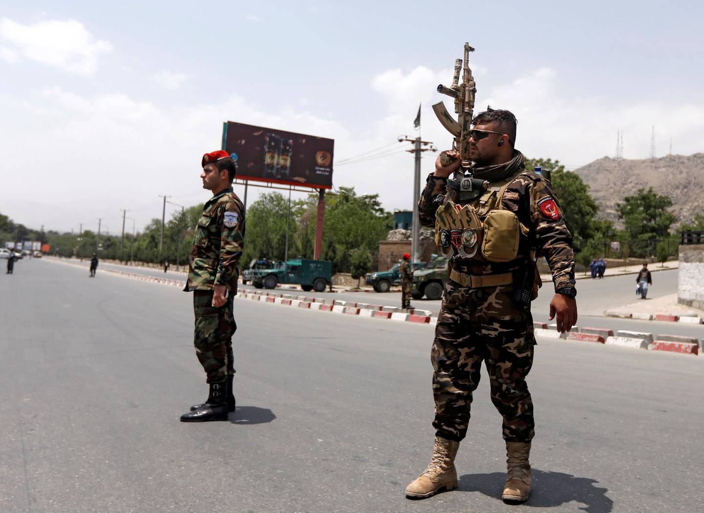 Afghan security forces keep watch at the site of a suicide attack in Kabul, Afghanistan June 4, 2018. REUTERS/Omar Sobhani