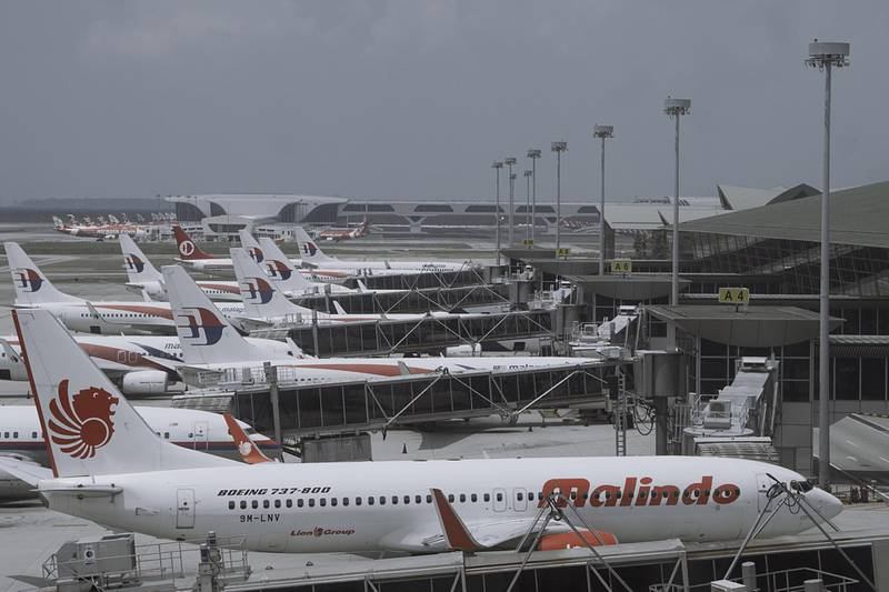 SEPANG, MALAYSIA - MARCH 21: Aircrafts from different airlines are seen grounded in Kuala Lumpur International Airport (KLIA) on March 21, 2020 in Sepang, Malaysia. Under the Movement Control Order (MCO), thousands of flights out of KLIA have been cancelled or rescheduled.  The measures were introduced in an attempt to stop the spread of coronavirus (COVID-19). (Photo by Rahman Roslan/Getty Images)