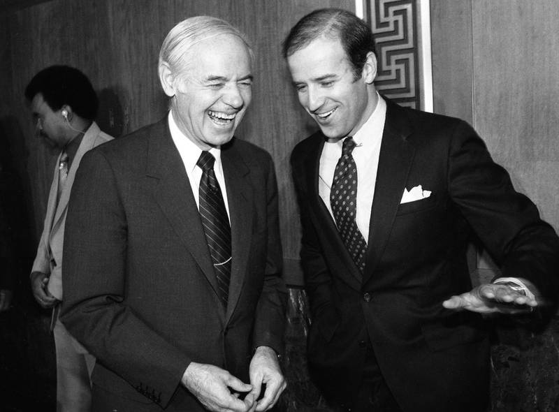 Attorney General William French Smith and Senator Joseph Biden, share a joke shortly before a hearing where Smith outlined the administration's request for an arsenal of new legal weapons against racketeers. (Photo by Bettmann Archive/Getty Images)