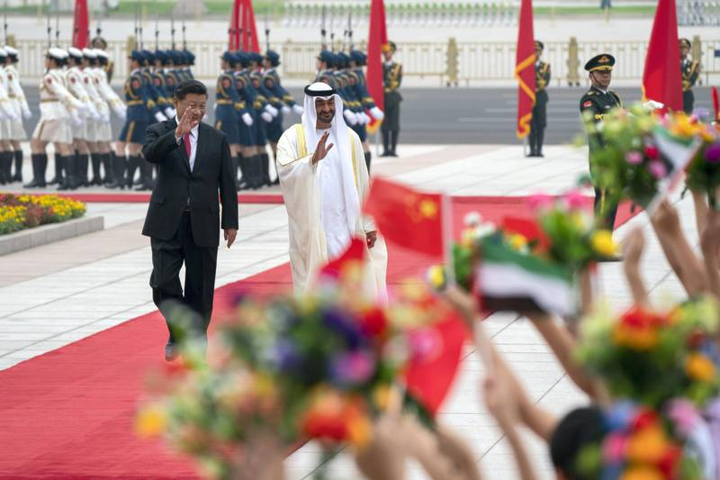 BEIJING, CHINA - July 22, 2019: HH Sheikh Mohamed bin Zayed Al Nahyan, Crown Prince of Abu Dhabi and Deputy Supreme Commander of the UAE Armed Forces (2nd L), attends a reception hosted by HE Xi Jinping, President of China (L), at the Great Hall of the People.  ( Mohamed Al Hammadi / Ministry of Presidential Affairs ) ---