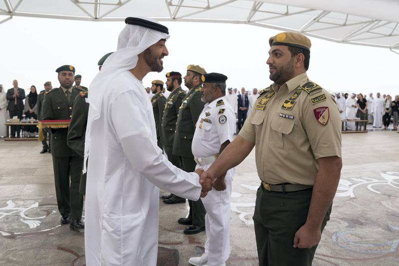 ABU DHABI, UNITED ARAB EMIRATES - April 23, 2018: HH Sheikh Mohamed bin Zayed Al Nahyan Crown Prince of Abu Dhabi Deputy Supreme Commander of the UAE Armed Forces (L), awards a member of the UAE Armed Forces with a Medal of Bravery for his service in Yemen, during a Sea Palace barza.  ( Mohamed Al Hammadi / Crown Prince Court - Abu Dhabi ) ---