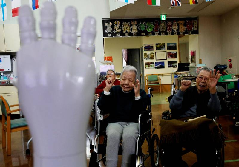 """Residents follow moves made by humanoid robot 'Pepper' during an afternoon exercise routine at Shin-tomi nursing home in Tokyo, Japan, February 2, 2018. REUTERS/Kim Kyung-Hoon  SEARCH """"KYUNG-HOON ROBOTS"""" FOR THIS STORY. SEARCH """"WIDER IMAGE"""" FOR ALL STORIES."""