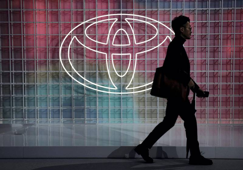 A man walks past a Toyota logo at the Tokyo Motor Show, in Tokyo, Japan October 24, 2019. REUTERS/Edgar Su