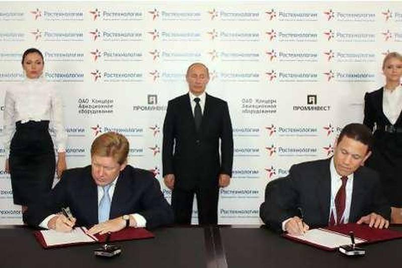 Mr Mikhail Shelkov , CEO of Prominvest, left,  and Mr Badr Jafar, Executive Director of the Crescent Group and Vice Chairman of Gulftainer, right. Behind them stands Russian Prime Minister Vladimir Putin.  Courtesy of SAHARA Communications