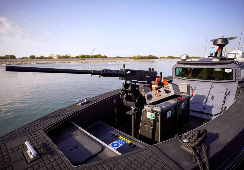 Abu Dhabi, United Arab Emirates, February 23, 2021.  Idex 2021 Day 3.Aksum Marine at NAVDEX. A .50 caliber heavy machine gun mounted on the Chaser 980 speedboat.Victor Besa / The NationalSection:  NAReporter: