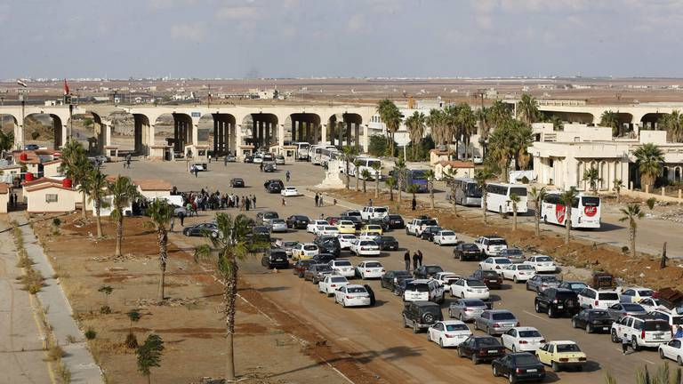 An image that illustrates this article Jordan opens main crossing with Syria in boost for economies