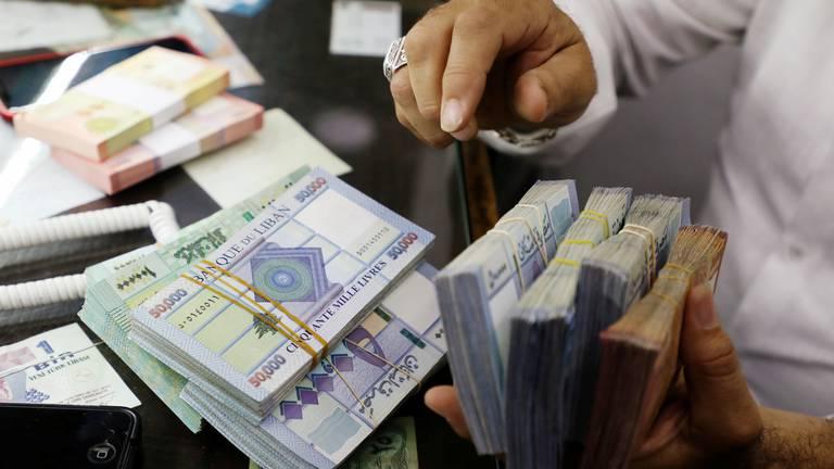An image that illustrates this article Lebanon faces 'tough task' as IMF talks restart, Capital Economics says