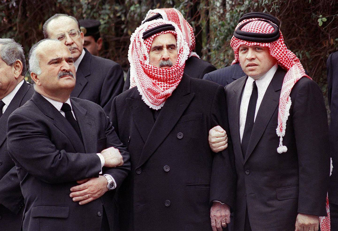 Jordanian King Abdallah (R) stands with his uncles Prince Mohammad (C) and Prince Hassan during the funeral procession of his father, King Hussien, who was buried 08 February in Amman. King Hussein died 07 February at the age of 63 after losing his seven-month-long battle against cancer. (Photo by KHALIL MAZRAAWI / AFP)