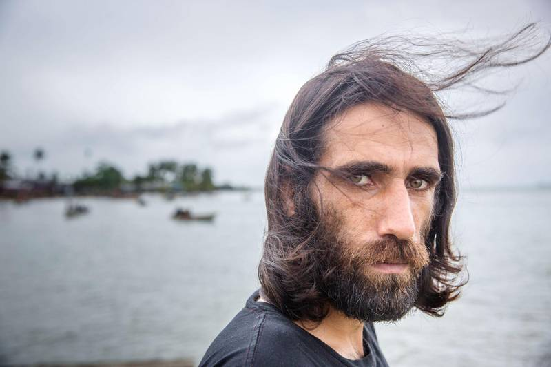 MANUS ISLAND, PAPUA NEW GUINEA - 2018/02/05: Whistle-blower Behrouz Boochani, a Kurdish asylum seeker at Manus island.  If not for Behrouz Boochani, their plight might never have been known.  The human cost of Australias offshore detention policy has been high for those unfortunate enough to have been caught in its net. For asylum seekers trapped on the remote island of Manus in Papua New Guinea, the future remains as uncertain as ever. Australias offshore detention center there was destroyed in 31 October 2017 but for the 600 or so migrants who remain on the remote Pacific island, little has changed. The asylum seekers live with the torment of separation from family and friends and in the shadow of depression and the traumas of their past. (Photo by Jonas Gratzer/LightRocket via Getty Images)