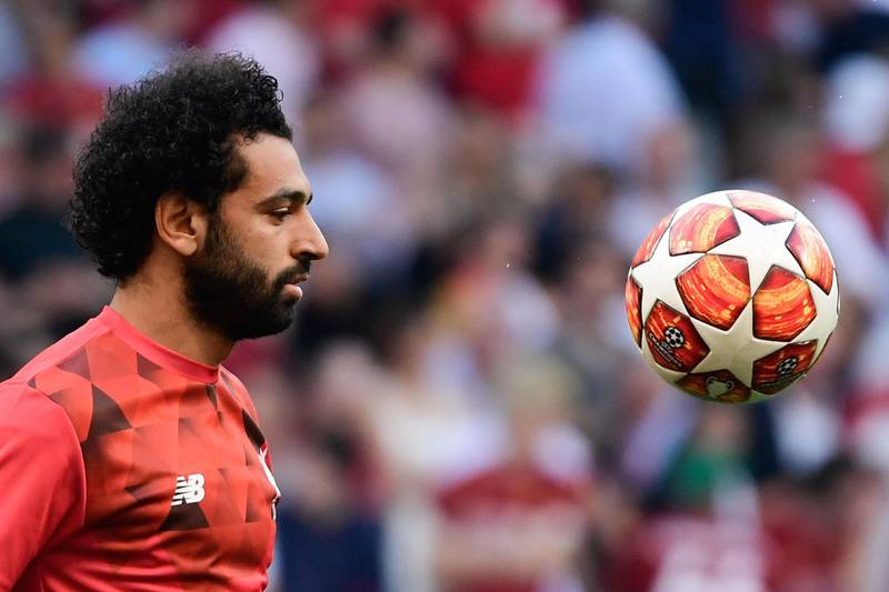 (FILES) A file photo taken on June 01, 2019 shows Liverpool's Egyptian midfielder Mohamed Salah warming up before the start of the UEFA Champions League final football match between Liverpool and Tottenham Hotspur at the Wanda Metropolitan Stadium in Madrid. / AFP / JAVIER SORIANO