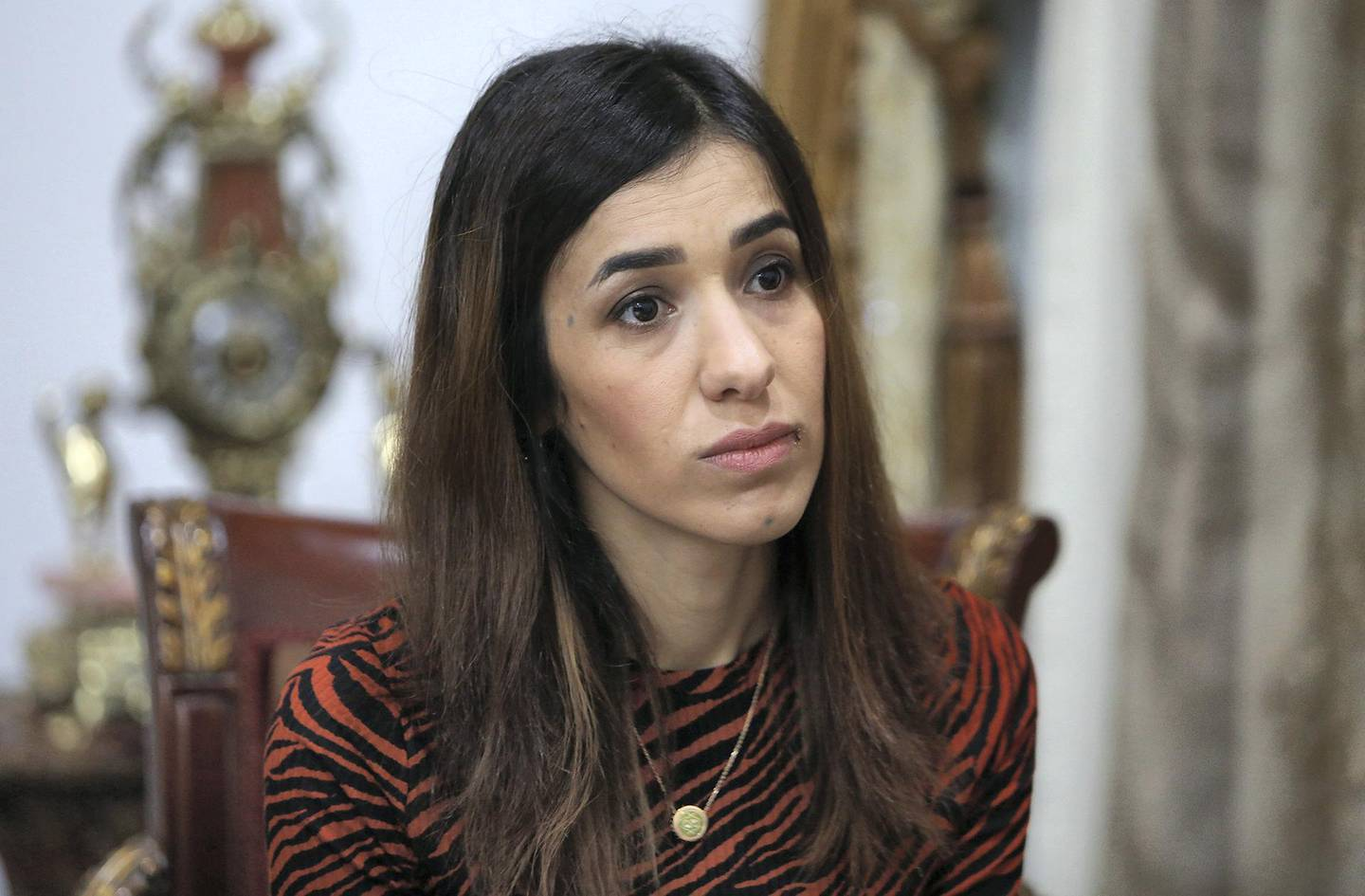 Iraqi Nobel laureate Nadia Murad gestures during a meeting with Iraq's president on December 12, 2018 in Baghdad. - Murad survived the worst of the cruelties and brutality inflicted on her people, the Yazidis of Iraq, by the Islamic State group before becoming a global champion of their cause and a Nobel Peace Prize laureate. (Photo by SABAH ARAR / AFP)