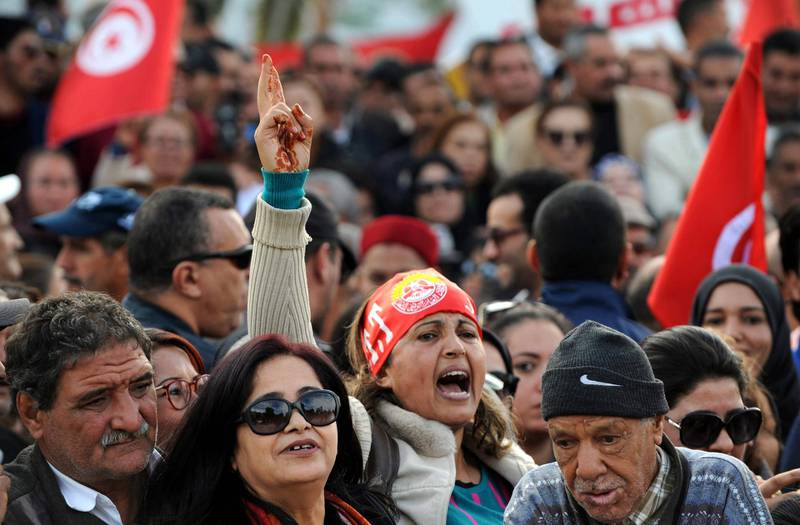 epa07183174 People protest during a general strike in Tunis, Tunisia, 22 November 2018. Some 670 thousand civil servants went on strike on 22 November 2018 after the Tunisian General Labor Union (UGTT) and the Tunisia government failed to reach an agreement to increase the salaries by the government. Protesters said that the loan by the International Monetary Fund (IMF) to Tunisia was one of the main factors of the government refusal. Tunisia agreed in 2016 a 2.8 billion US dollars loan from the IMF. The general strike included all public sectors subjected to the civil service law, with minimum level of service guaranteed in vital sectors like emergency services.  EPA/STR