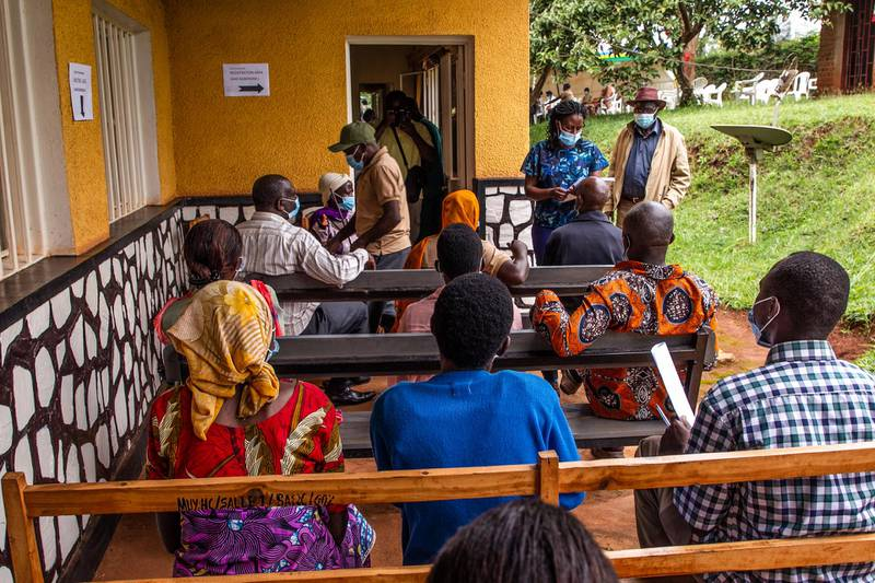 Eldery people wait for receiving the first injection of Oxford AstraZeneca Covid-19 vaccine at Muyumbu Health Center in Rwamagana, East Kigali, on March 5, 2021. (Photo by - / AFP)