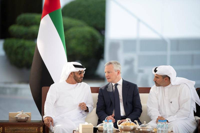 ABU DHABI, UNITED ARAB EMIRATES - February 24, 2020: HH Sheikh Mohamed bin Zayed Al Nahyan, Crown Prince of Abu Dhabi and Deputy Supreme Commander of the UAE Armed Forces (L) receives HE Bruno Le Maire, Minster of Economy and Finance of France (C), during a Sea Palace barza. Seen with HE Khaldoon Khalifa Al Mubarak, CEO and Managing Director Mubadala, Chairman of the Abu Dhabi Executive Affairs Authority and Abu Dhabi Executive Council Member (R).   ( Saeed Al Mehairi / Ministry of Presidential Affairs ) ---
