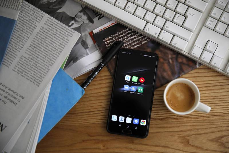 A smartphone sits next to a cup of espresso on the desk of a home office in an arranged photograph taken in Bern, Switzerland, on Wednesday, April 1, 2020. The Covid-19 pandemic has triggered a seismic wave of health awareness and anxiety, which is energizing a new category of virus-fighting tech and apps. Photographer: Stefan Wermuth/Bloomberg