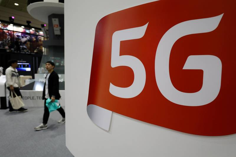 Signage for 5G is displayed at the KT Corp. booth at the World IT Show 2018 in Seoul, South Korea, on Wednesday, May 23, 2018. The show runs through May 27. Photographer: SeongJoon Cho/Bloomberg