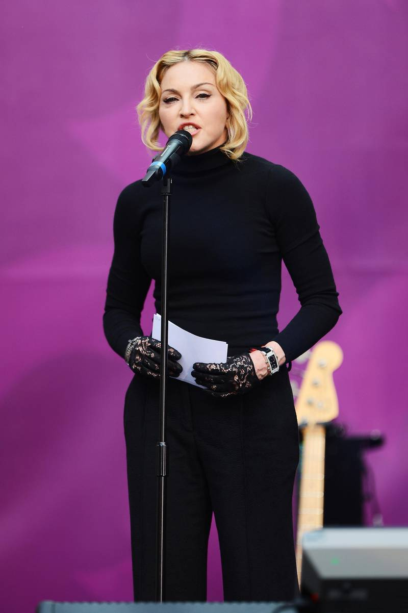 """LONDON, ENGLAND - JUNE 01:  Singer Madonna speaks on stage at the """"Chime For Change: The Sound Of Change Live"""" Concert at Twickenham Stadium on June 1, 2013 in London, England. Chime For Change is a global campaign for girls' and women's empowerment founded by Gucci with a founding committee comprised of Gucci Creative Director Frida Giannini, Salma Hayek Pinault and Beyonce Knowles-Carter.  (Photo by Ian Gavan/Getty Images for Gucci)"""