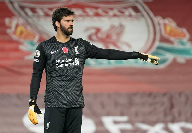 LIVERPOOL, ENGLAND - OCTOBER 31: Alisson Becker of Liverpool gives his team instructions during the Premier League match between Liverpool and West Ham United at Anfield on October 31, 2020 in Liverpool, England. Sporting stadiums around the UK remain under strict restrictions due to the Coronavirus Pandemic as Government social distancing laws prohibit fans inside venues resulting in games being played behind closed doors. (Photo by Jon Super - Pool/Getty Images)