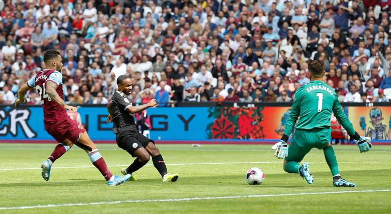 Manchester City's English midfielder Raheem Sterling (C) scores their second goal during the English Premier League football match between West Ham United and Manchester City at The London Stadium, in east London on August 10, 2019. (Photo by Ian KINGTON / AFP) / RESTRICTED TO EDITORIAL USE. No use with unauthorized audio, video, data, fixture lists, club/league logos or 'live' services. Online in-match use limited to 120 images. An additional 40 images may be used in extra time. No video emulation. Social media in-match use limited to 120 images. An additional 40 images may be used in extra time. No use in betting publications, games or single club/league/player publications. /
