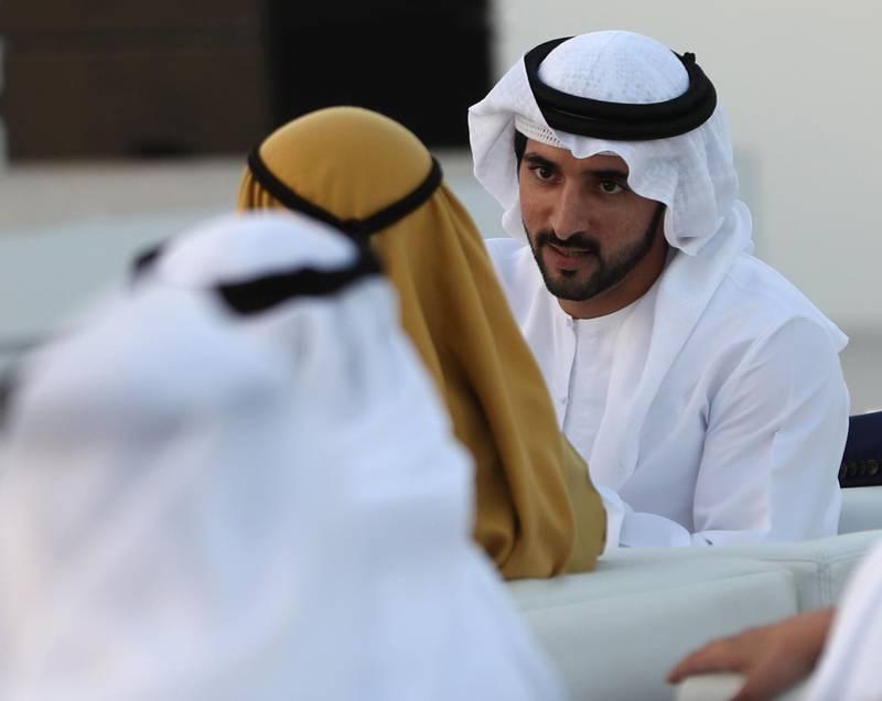 Dubai's Crown Prince Sheikh Hamdan bin Mohammed bin Rashid Al-Maktoum (R), is pictured during a ceremony presenting the new logo of Dubai Airoprt, in Dubai, on February 13, 2019. / AFP / KARIM SAHIB