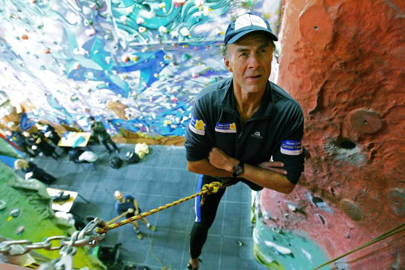British Explorer, Sir Ranulph Fiennes, aged 62, scales a climbing wall during a press conference in East London, 26 February 2007. Fiennes will attempt to climb the north face of the Eiger Mountain in the Swiss Alps in March 2007 to raise money for the Marie Curie charity which cares for terminally ill patients. Fiennes suffers from vertigo, a heart condition and has lost fingers from his left hand to frost bite.  AFP PHOTO/CARL DE SOUZA / AFP PHOTO / CARL DE SOUZA