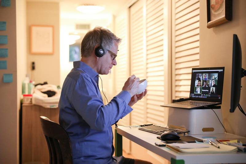 Doug Hassebroek eats breakfast while on a video conference call working from home during the outbreak of the coronavirus disease (COVID-19) in Brooklyn, New York City, New York, U.S., April 24, 2020. REUTERS/Caitlin Ochs