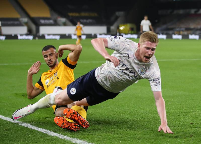 Soccer Football - Premier League - Wolverhampton Wanderers v Manchester City - Molineux Stadium, Wolverhampton, Britain - September 21, 2020 Manchester City's Kevin De Bruyne is fouled in the penalty area by Wolverhampton Wanderers' Romain Saiss and a penalty is awarded Pool via REUTERS/Nick Potts EDITORIAL USE ONLY. No use with unauthorized audio, video, data, fixture lists, club/league logos or 'live' services. Online in-match use limited to 75 images, no video emulation. No use in betting, games or single club/league/player publications.  Please contact your account representative for further details.