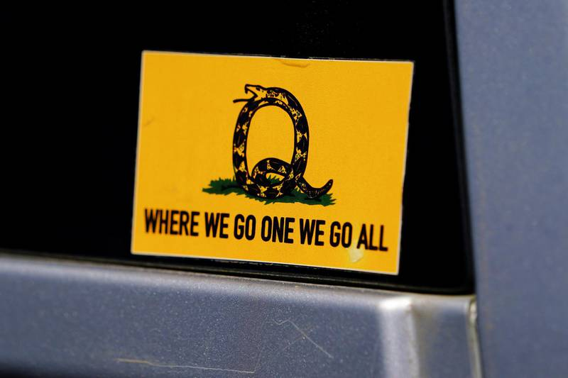FILE PHOTO: A sticker that references the QAnon slogan is seen on a truck that participated in a caravan convoy in Adairsville, Georgia, U.S. September 5, 2020.   REUTERS/Elijah Nouvelage/File Photo
