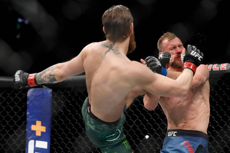 LAS VEGAS, NEVADA - JANUARY 18: Conor McGregor lands a kick to the face of Donald Cerrone in the first round in a welterweight bout during UFC246 at T-Mobile Arena on January 18, 2020 in Las Vegas, Nevada.   Steve Marcus/Getty Images/AFP
