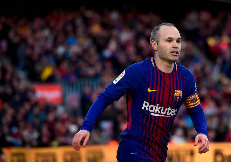 Barcelona's Spanish midfielder Andres Iniesta looks on during the Spanish league football match between FC Barcelona and Getafe CF at the Camp Nou stadium in Barcelona on February 11, 2018. / AFP PHOTO / Josep LAGO
