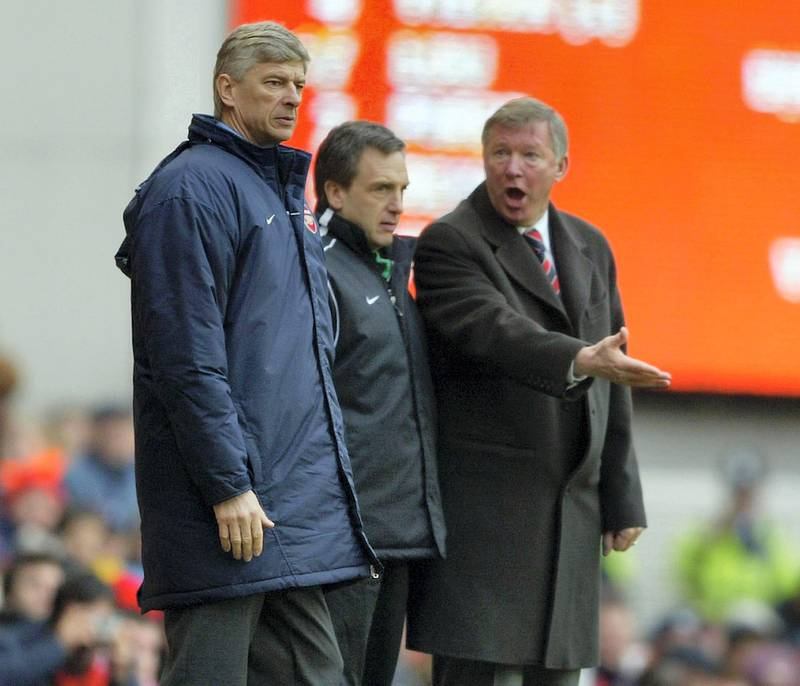 LONDON - MARCH 28:  Manager Arsene Wenger of Arsenal argues with manager Sir Alex Ferguson of Manchester United during the FA Barclaycard Premiership match between Arsenal and Manchester United at Highbury on March 28, 2004 in London.  (Photo by Clive Mason/Getty Images)