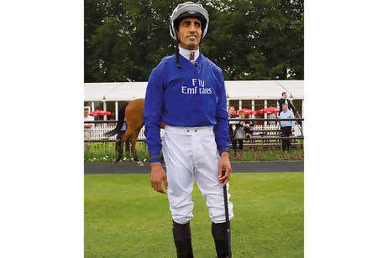 Ajtebi in the Paddock at Newmarket, the home of horse racing.Ahmed Ajtebi is a former camel racing jockey. Born in the UAE he now races horses for the Godolphin stable.