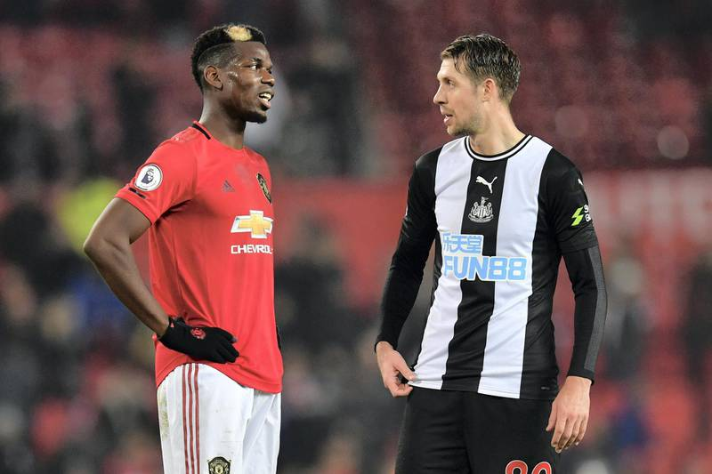 Manchester United's French midfielder Paul Pogba (L0 chats with Newcastle United's French midfielder Florian Lejeune (R) on the pitch after the English Premier League football match between Manchester United and Newcastle United at Old Trafford in Manchester, north west England, on December 26, 2019. - Manchester United won the game 4-1. (Photo by Paul ELLIS / AFP) / RESTRICTED TO EDITORIAL USE. No use with unauthorized audio, video, data, fixture lists, club/league logos or 'live' services. Online in-match use limited to 120 images. An additional 40 images may be used in extra time. No video emulation. Social media in-match use limited to 120 images. An additional 40 images may be used in extra time. No use in betting publications, games or single club/league/player publications. /