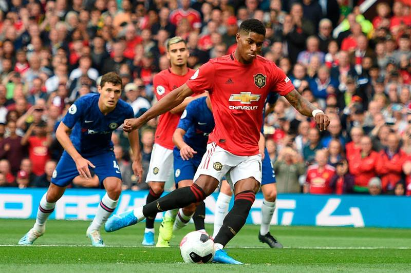 Manchester United's English striker Marcus Rashford (C) shoots to score from the penalty spot for the opening goal during the English Premier League football match between Manchester United and Chelsea at Old Trafford in Manchester, north west England, on August 11, 2019. RESTRICTED TO EDITORIAL USE. No use with unauthorized audio, video, data, fixture lists, club/league logos or 'live' services. Online in-match use limited to 120 images. An additional 40 images may be used in extra time. No video emulation. Social media in-match use limited to 120 images. An additional 40 images may be used in extra time. No use in betting publications, games or single club/league/player publications.  / AFP / Oli SCARFF                           / RESTRICTED TO EDITORIAL USE. No use with unauthorized audio, video, data, fixture lists, club/league logos or 'live' services. Online in-match use limited to 120 images. An additional 40 images may be used in extra time. No video emulation. Social media in-match use limited to 120 images. An additional 40 images may be used in extra time. No use in betting publications, games or single club/league/player publications.