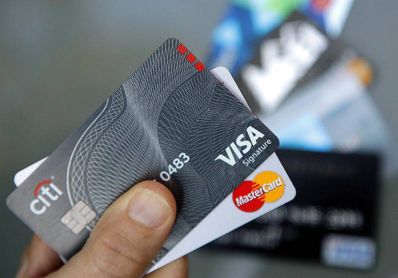 FILE - In this June 15, 2017, file photo, credit cards are displayed in Haverhill, Mass. If you have excellent credit, you can use your credit rating to your financial advantage without borrowing money. Oddly, exploiting your great credit rating often improves it. (AP Photo/Elise Amendola, File)