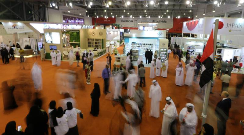 TO GO WITH AFP ARABIC STORY  Saudis attend the Sharjah International Book Fair in Sharjah, northeast of Dubai, on October 31, 2018. The fair will be held between October 31 and November 10, 2018. / AFP / KARIM SAHIB