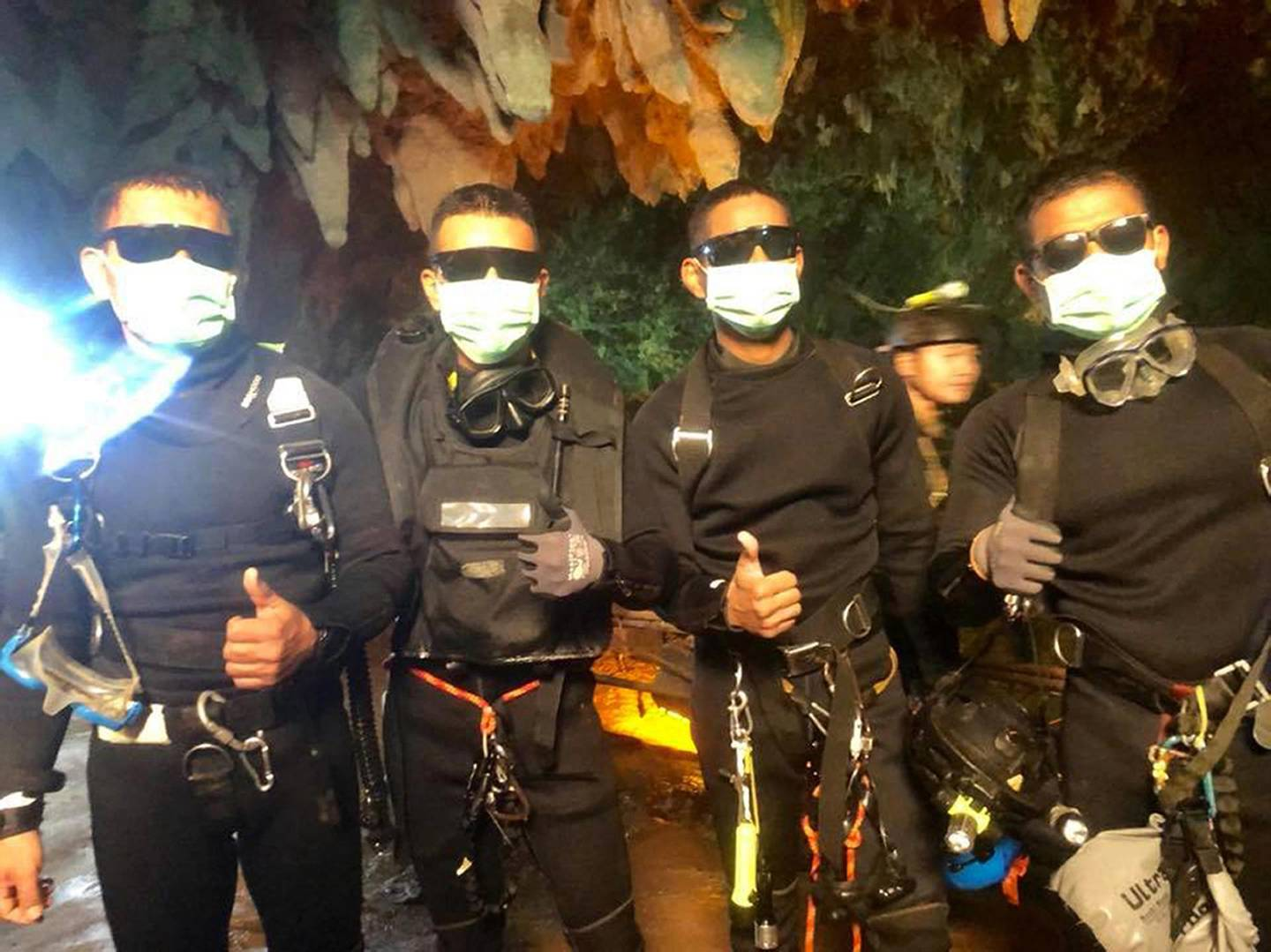 epa06878441 A handout photo made available by Thai Navy SEAL facebook page on 10 July 2018 shows the last four of Thai Navy Seals members, who stayed with the youth soccer team and their assistant coach inside a cave until they all were rescued, at the Tham Luang cave, Khun Nam Nang Non Forest Park in Chiang Rai province, Thailand, 10 July 2018. According to reports, all 12 boys of a child soccer team and their assistant coach have been rescued and evacuated to a hospital. The 12 youth and their assistant coach have been trapped in Tham Luang cave since 23 June 2018.  EPA/ROYAL THAI NAVY / HANDOUT  HANDOUT EDITORIAL USE ONLY/NO SALES
