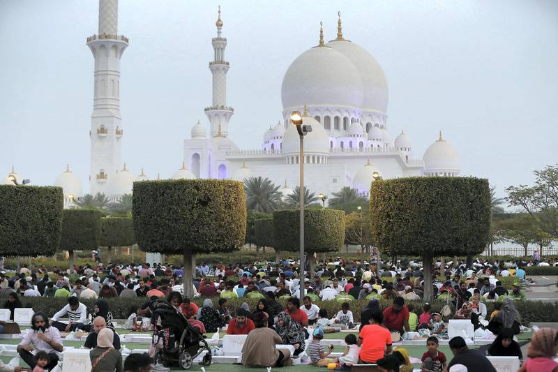 ABU DHABI,  UNITED ARAB EMIRATES , May 6 – 2019 :- People breaking their fast on the First day of Ramadan at the Sheikh Zayed Grand Mosque in Abu Dhabi. ( Pawan Singh / The National ) For News/Online/Big Picture/ Instagram