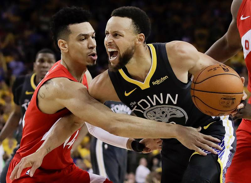 Golden State Warriors guard Stephen Curry, right, is defended by Toronto Raptors guard Danny Green during the second half of Game 4 of basketball's NBA Finals Friday, June 7, 2019, in Oakland, Calif. (AP Photo/Ben Margot)