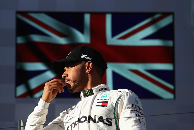 MELBOURNE, AUSTRALIA - MARCH 25:  Second placed Lewis Hamilton of Great Britain and Mercedes GP on the podium during the Australian Formula One Grand Prix at Albert Park on March 25, 2018 in Melbourne, Australia.  (Photo by Clive Mason/Getty Images)