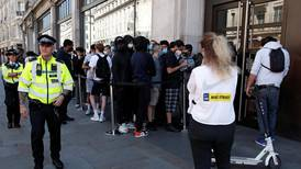 Thousands queue outside stores as shops in England reopen after coronavirus closures