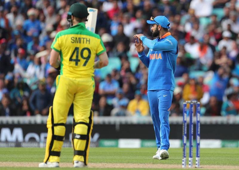 India's captain Virat Kohli, right, asks for television umpire's review for the wicket of Australia's Steve Smith, left, during the Cricket World Cup match between Australia and India at The Oval in London, Sunday, June 9, 2019. (AP Photo/Aijaz Rahi)