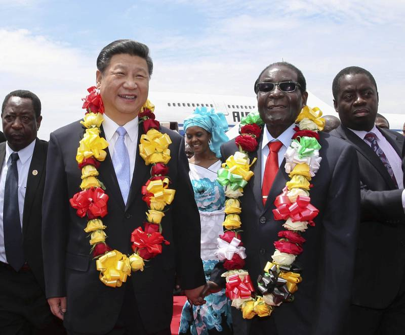 Mandatory Credit: Photo by Xinhua/Shutterstock (5460164a)Chinese President Xi Jinping (L, front) is welcomed by Zimbabwean President Robert Mugabe in Harare, ZimbabweChinese President Xi Jinping visit to Harare, Zimbabwe - 01 Dec 2015Xi arrived here Tuesday for a state visit to Zimbabwe