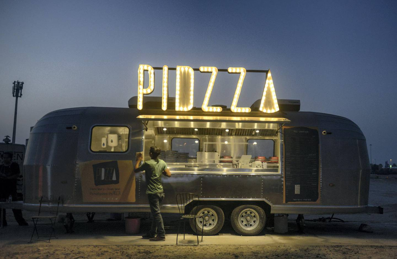 Abu Dhabi, United Arab Emirates - Food Trucks parked on May 20, 2018. (Khushnum Bhandari/ The National)