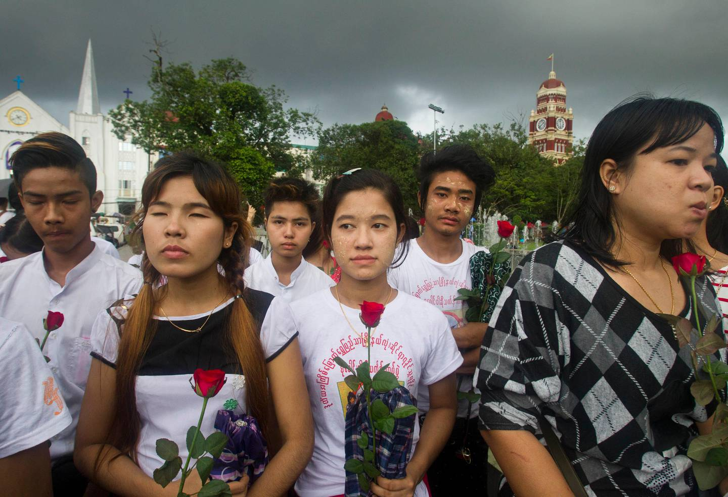 Protesters holding roses attend a protest in front of city hall in Yangon, Myanmar, Sunday Sept. 3, 2017. Myanmar activists took part in a protest Sunday, praying for victims killed during conflict and condemning the attacks carried out in Rakhine state, western Myanmar. (AP Photo)