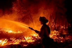 Woman charged with arson as bushfire forces evacuations in California