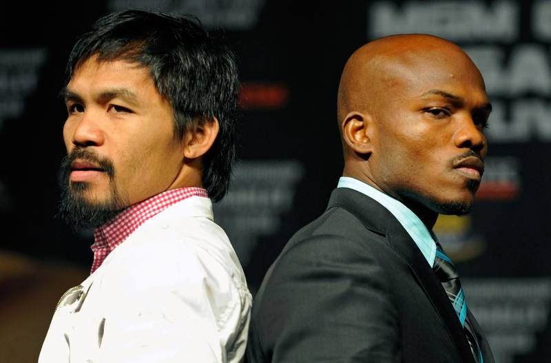 LAS VEGAS, NV - JUNE 06: Boxers Manny Pacquiao (L) and Timothy Bradley pose during the final news conference for their bout at the MGM Grand Hotel/Casino June 6, 2012 in Las Vegas, Nevada. Pacquiao will defend his WBO welterweight title against Bradley when the two meet in the ring on June 9 in Las Vegas. (Photo by David Becker/Getty Images)