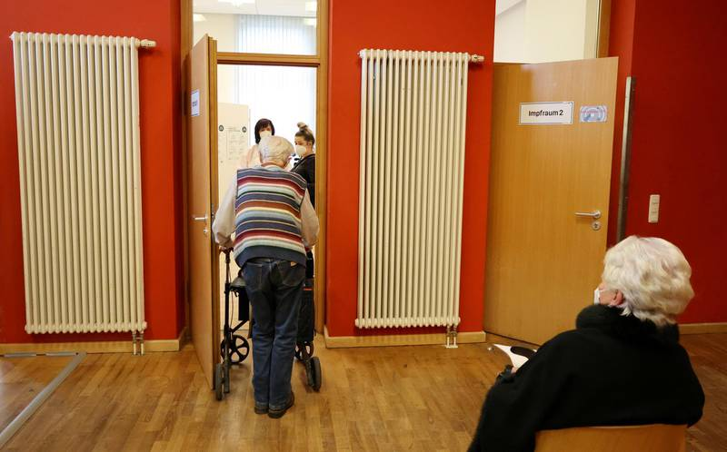 An elderly man enters a COVID-19 vaccination centre temporarily set up in a former cinema in Weimar, Germany, January 13, 2021. REUTERS/Karina Hessland REFILE - CORRECTING GENDER