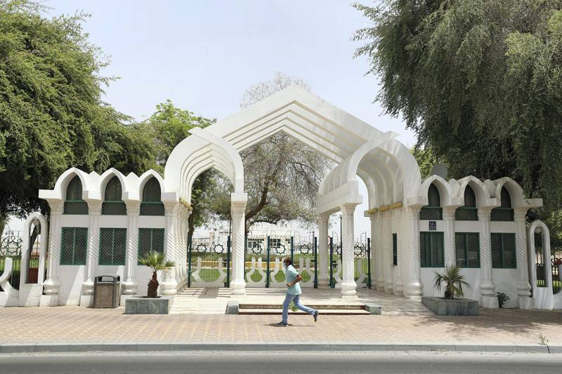 Al Ain, United Arab Emirates - Reporter: N/A: A man wearing a facemask runs passed a closed park in Al Ain. Thursday, April 9th, 2020. Al Ain. Chris Whiteoak / The National